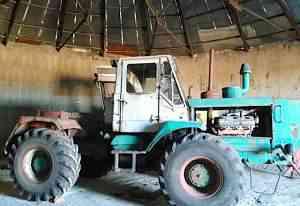 Трактор Т150, телега 12 птэс, плуг пяти корпусный