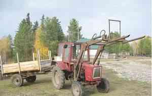 трактор Т-25, с ним кун, телега, косилка, д