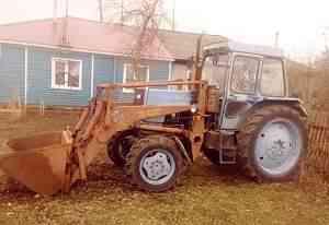 Трактор лтз (с куном, копнителем (вилы) и двигушей