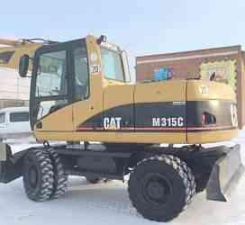 Экскаватор колесный Cat m315c